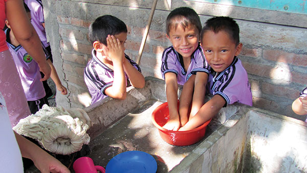 El Salvador Boys Washing Hands