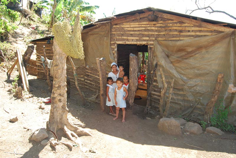 El Salvador Family in Doorway of Home