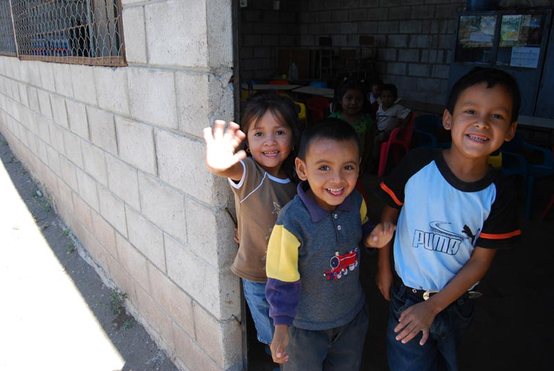 El Salvador Smiling Children in Doorway