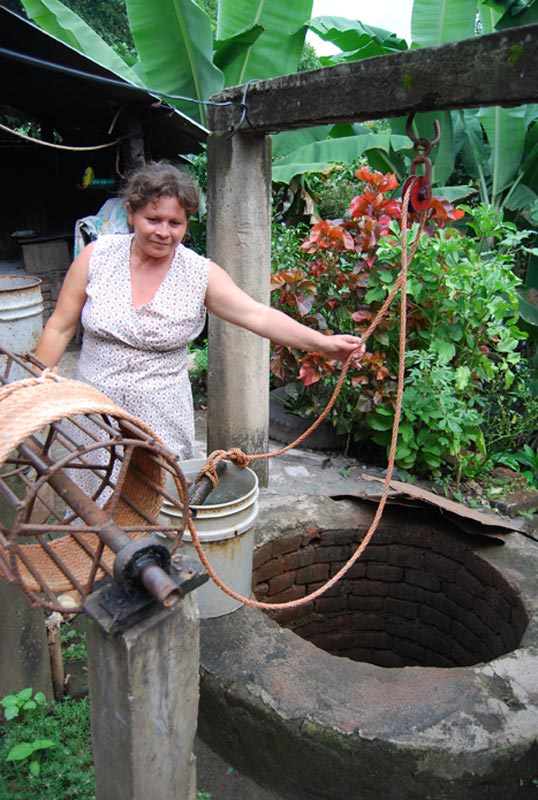 El Salvador Woman at Well