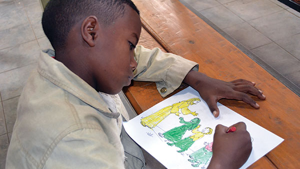 Ethiopia Boy Coloring a Picture