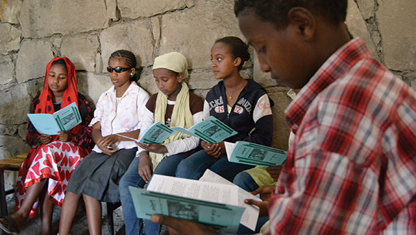 Ethiopia Girls Reading a Pamphlet