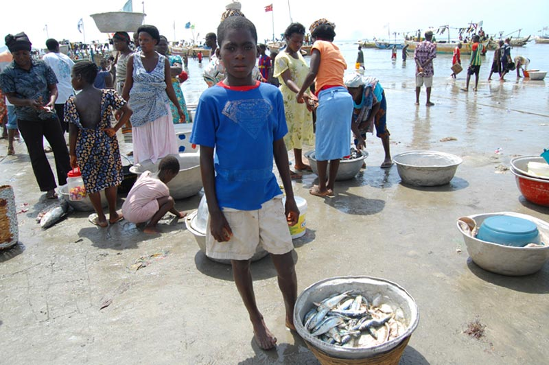 Ghana Boy with a Bowl of Fish