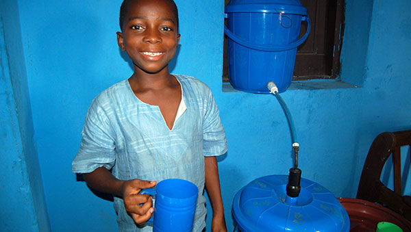 Ghana Boy with a Compassion Safe Water System