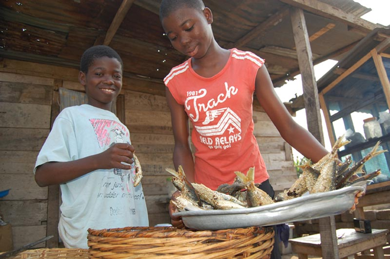 Ghana Boys With a Plate of Fish