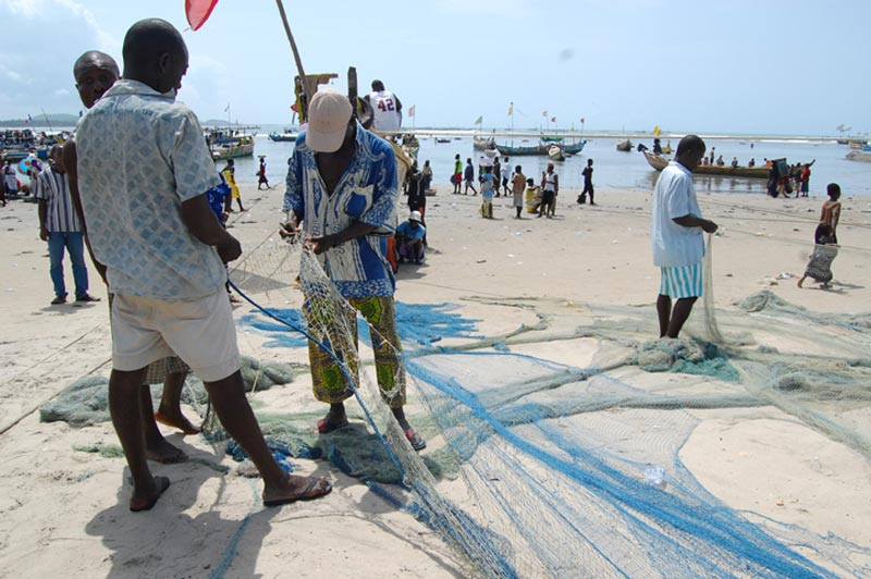 Ghana Man Fixing a Fishing Net