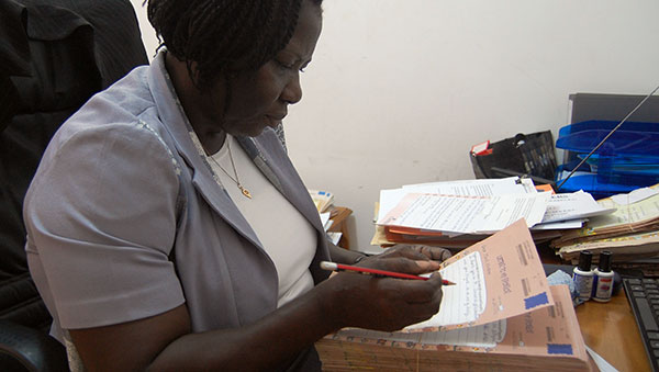 Ghana Woman Translating Child Letters