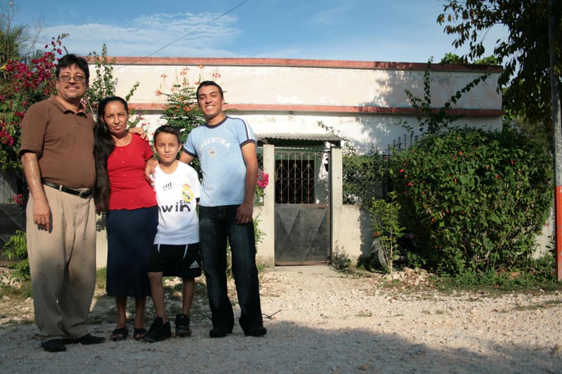 Guatemala Family Outside Home