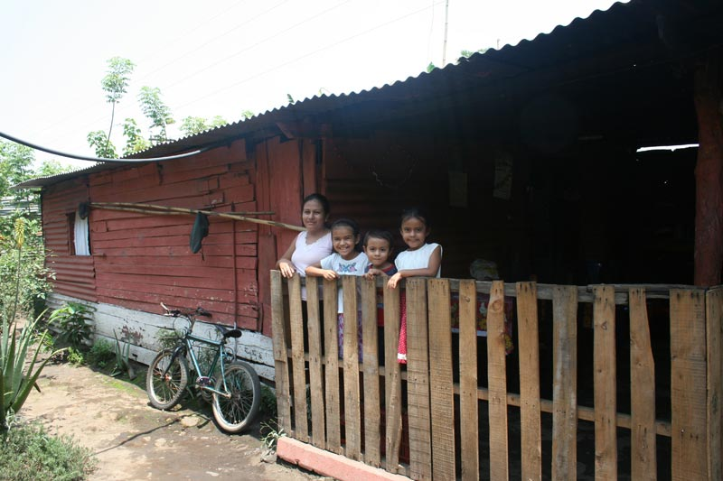 Guatemala Family Standing at Fence