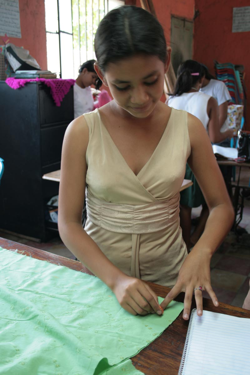 Guatemala Girl Working with Fabric