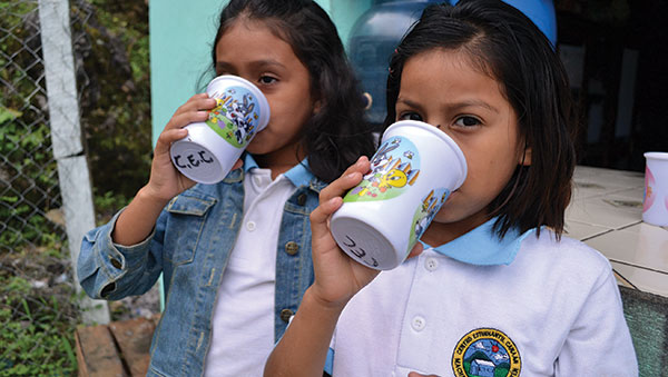 Guatemala Girls Drinking Water
