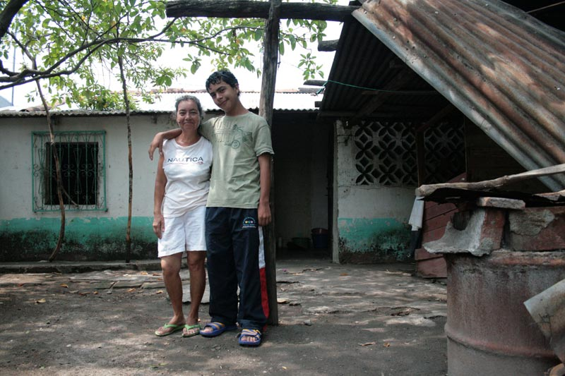 Guatemala Mother and Son Outside Home