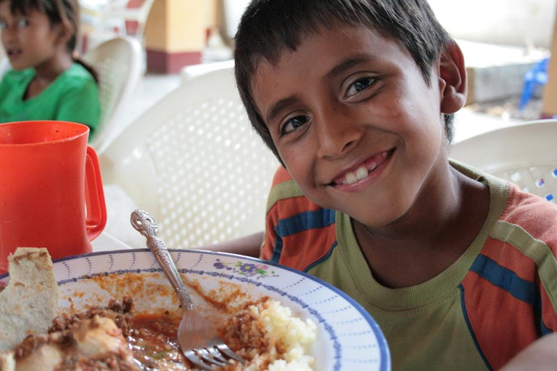 Guatemala Smiling Boy with Food