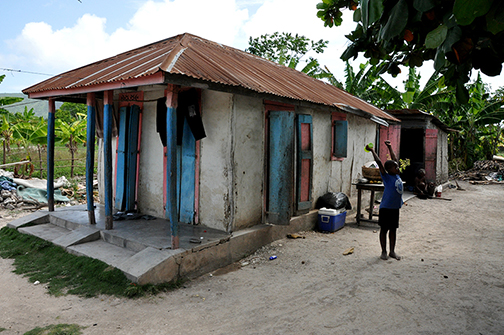 Haiti Child Outside Small Home