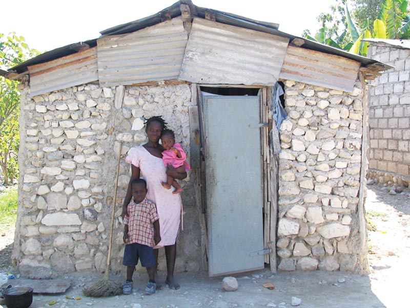 Haiti Family Outside Stone Home