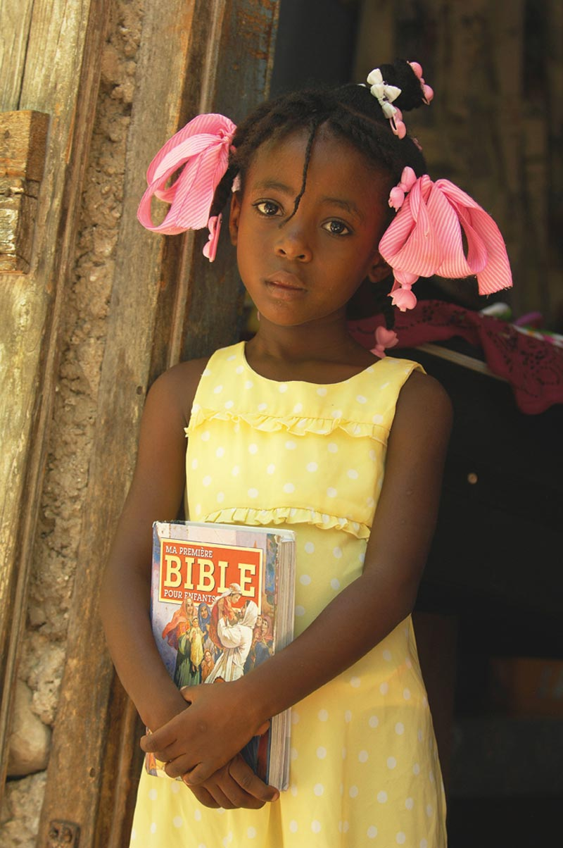 Haiti Girl Holding Bible