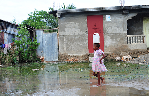 Haiti Girl Walking in Water