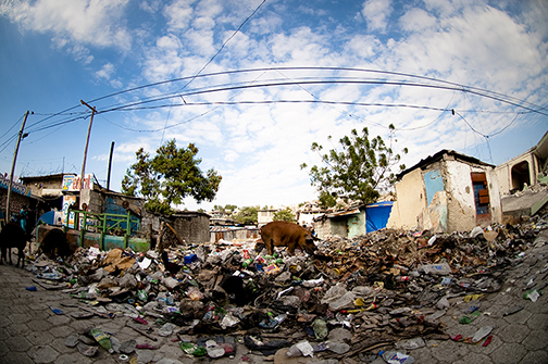 Haiti Trash in Front of Buildings