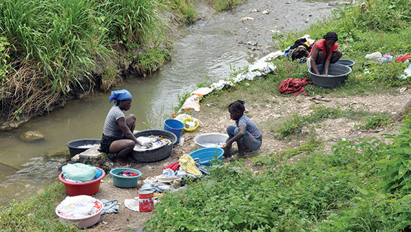Haiti Women Washing Clothes