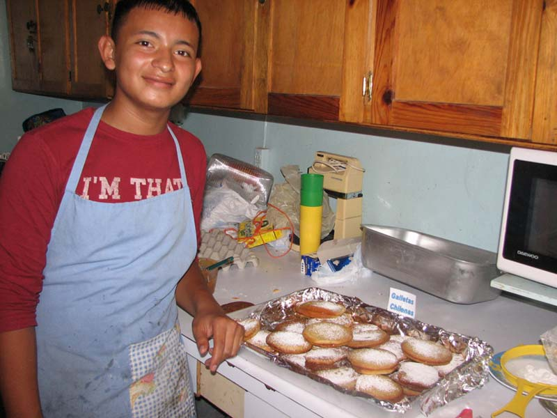 Honduras Boy Baking Cookies