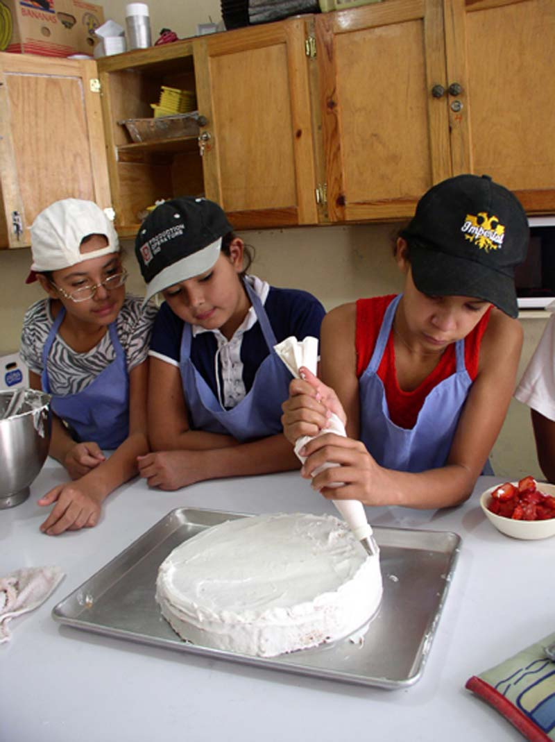 Honduras Children Decorating a Cake