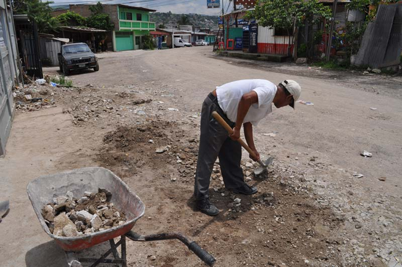 Honduras Man Digging in Dirt