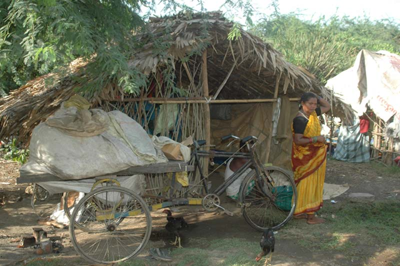 India bicycle outside small home