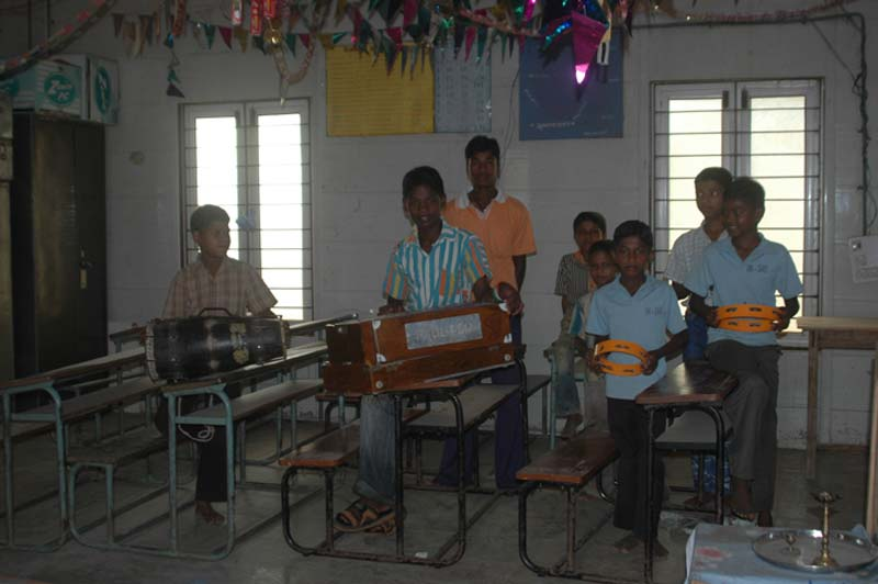 India boys holding instruments