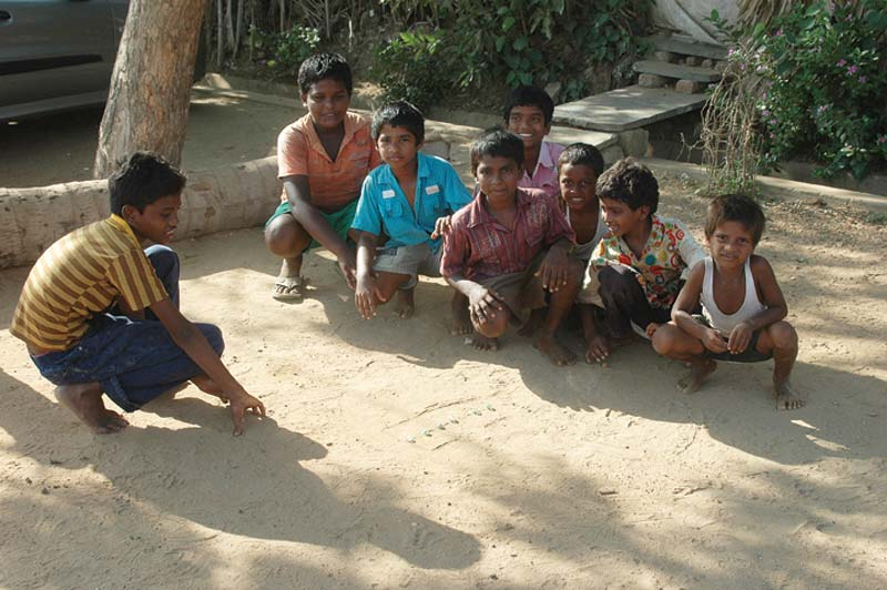 India boys playing in dirt