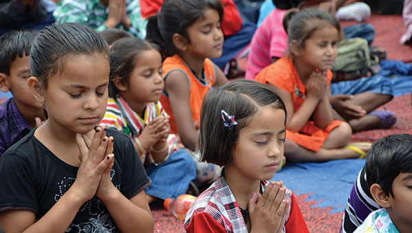 India children praying together