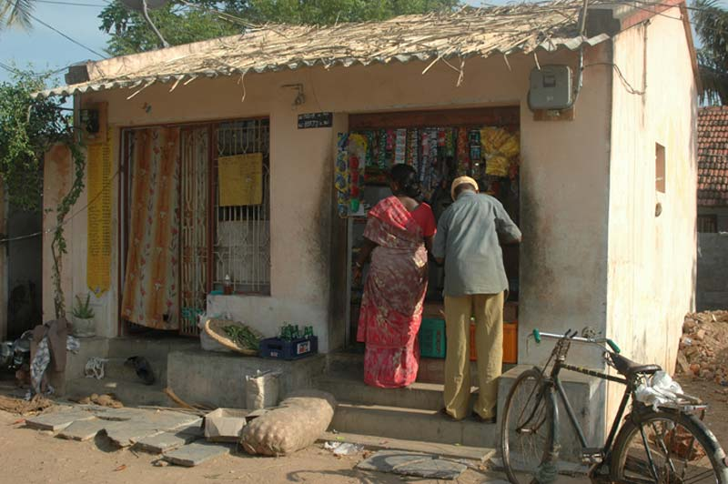 India man and woman at small shop
