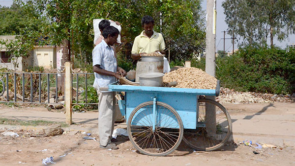 India man with blue cart