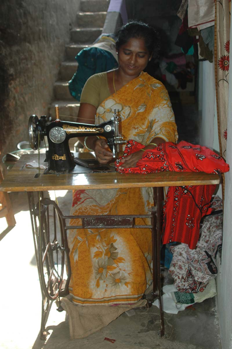 India woman at sewing machine