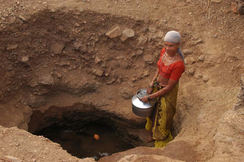 India woman at water hole