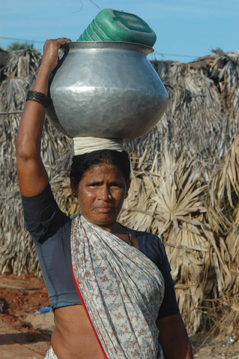 India woman carrying pot on head