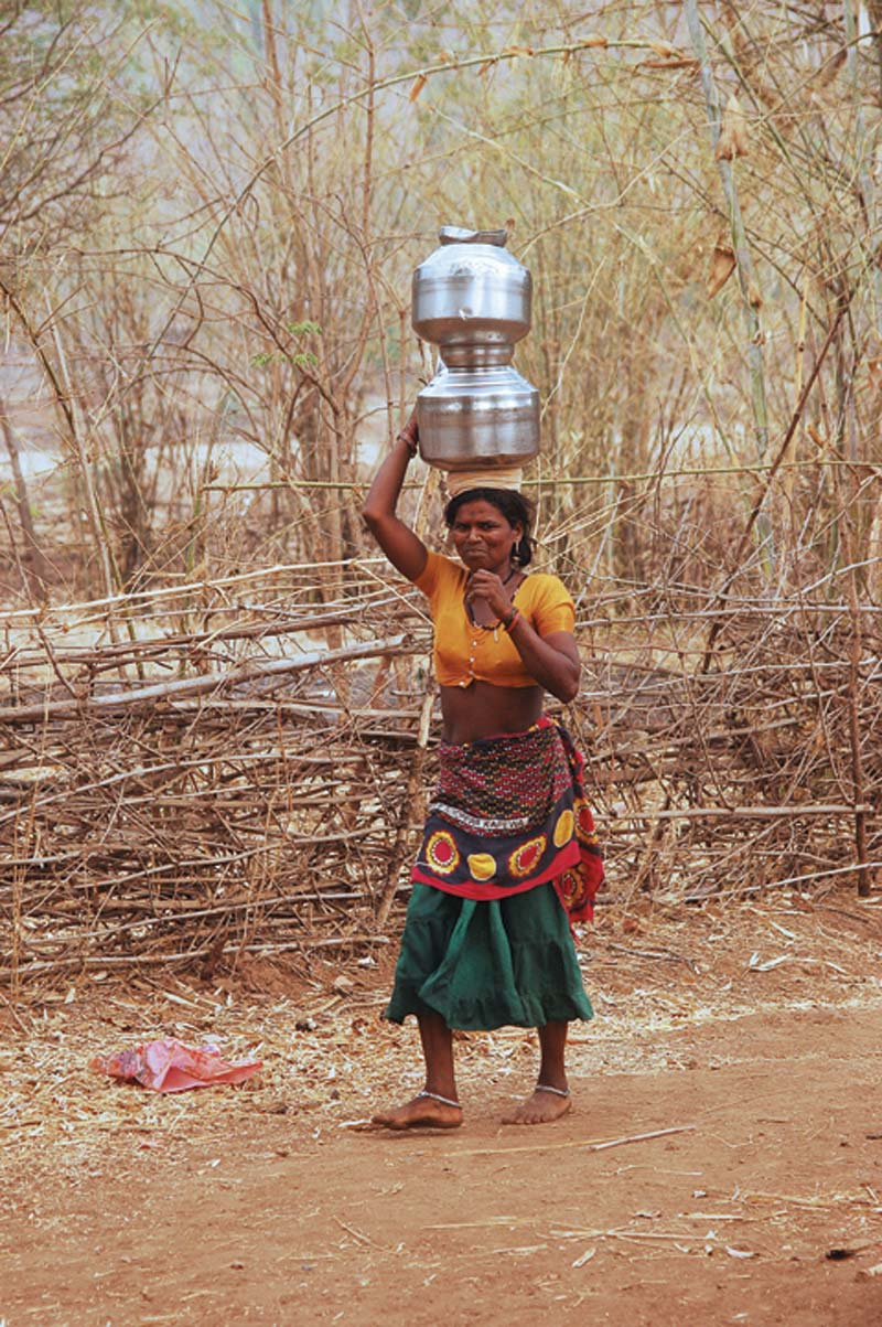 India woman carrying pots on head