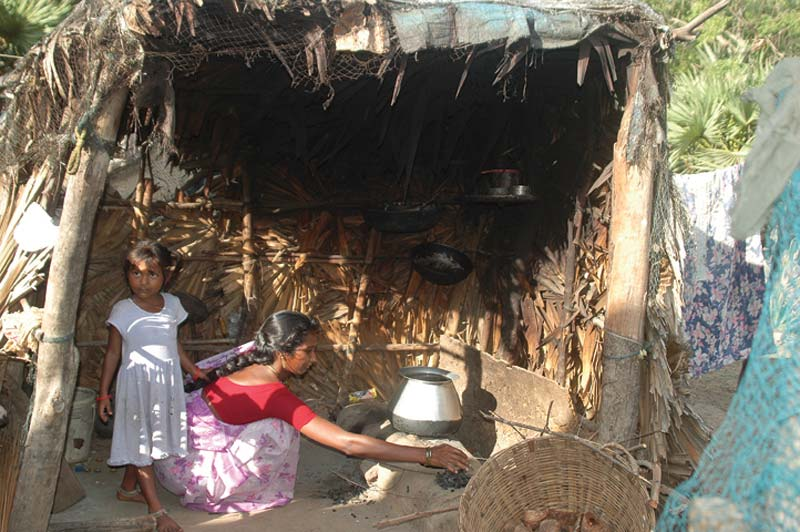 India women in small cooking hut