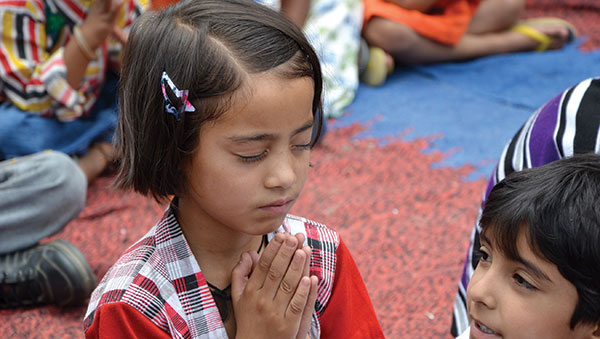 India young girl praying