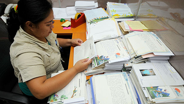 Indonesia woman reading sponsor letters