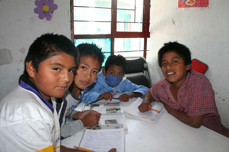 Mexico Boys Studying At A Table