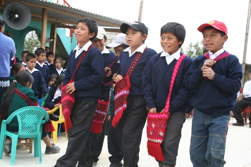 Mexico Boys in Uniforms With Red Bags