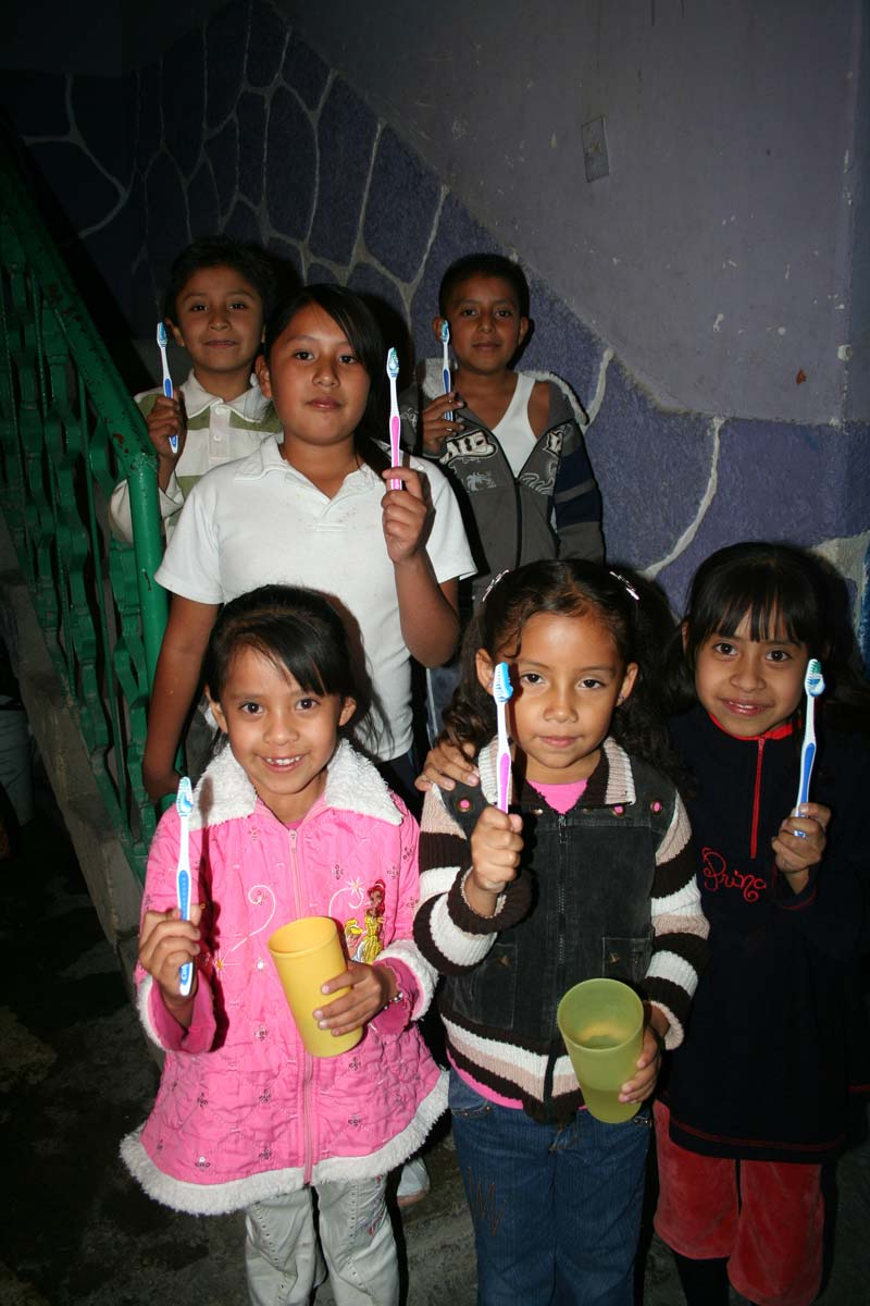 Mexico Children Holding Toothbrushes