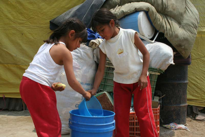 Mexico Girls Washing Their Hands in a Bucket