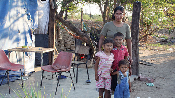 Mexico Mother and Her Children Outside Their Home