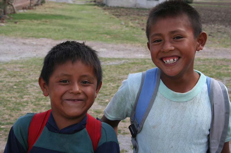 Mexico Two Smiling Boys Wearing Backpacks