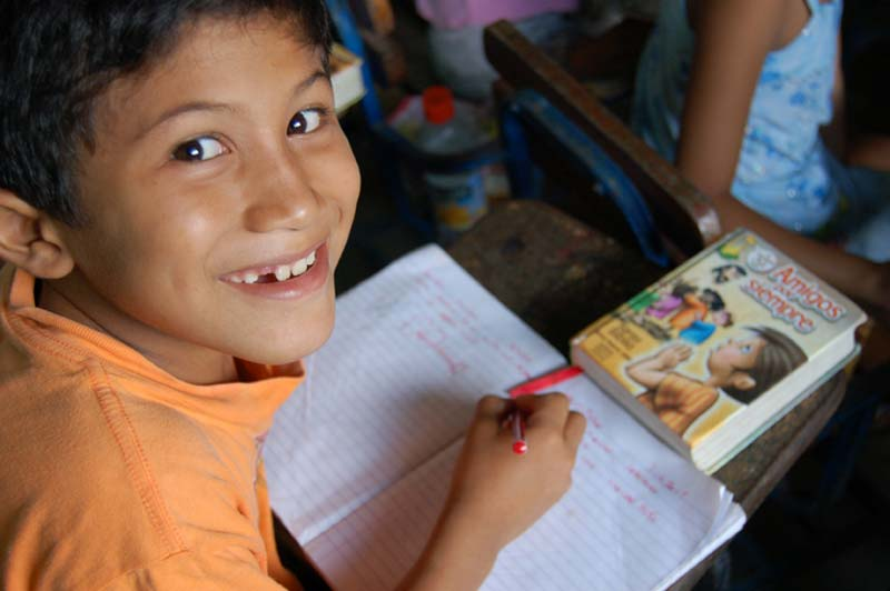 Nicaragua Boy Writing in Notebook
