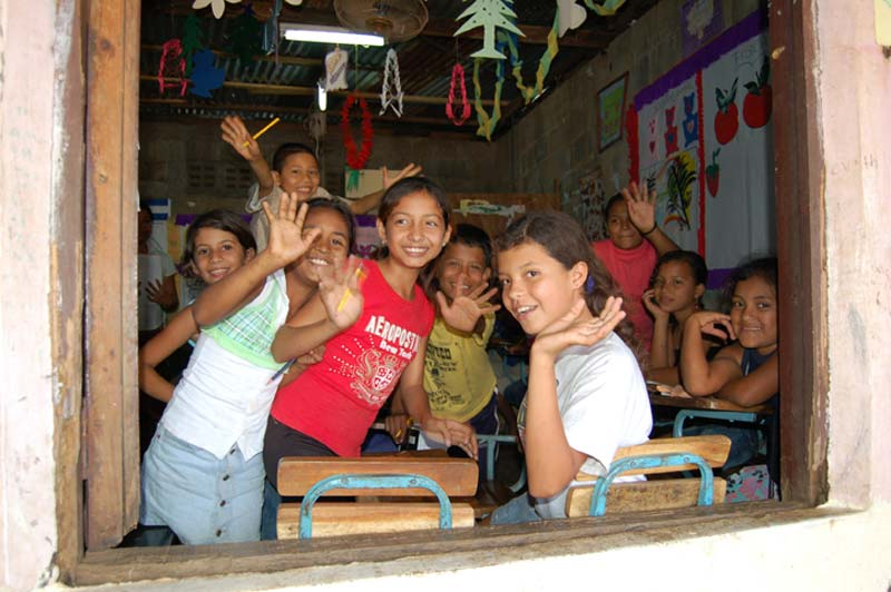 Nicaragua Children Waving From a Classroom