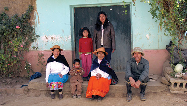 Peru Family Sitting on Front Step of Home