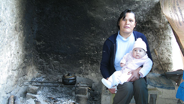 Peru Mother and Baby Cooking Near Fire
