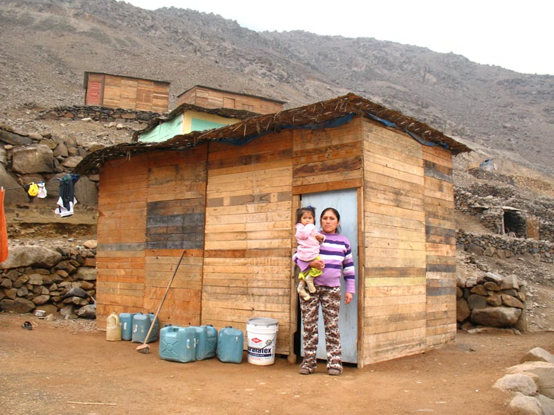 Peru Mother and Daughter Outside Their Home